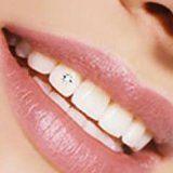 Существует ли опасность в зубных украшениях