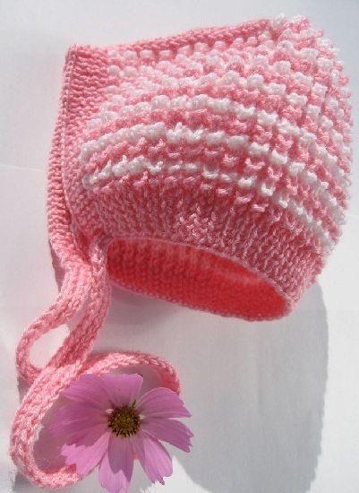 Вязаная шапочка для новорожденной девочки спицами